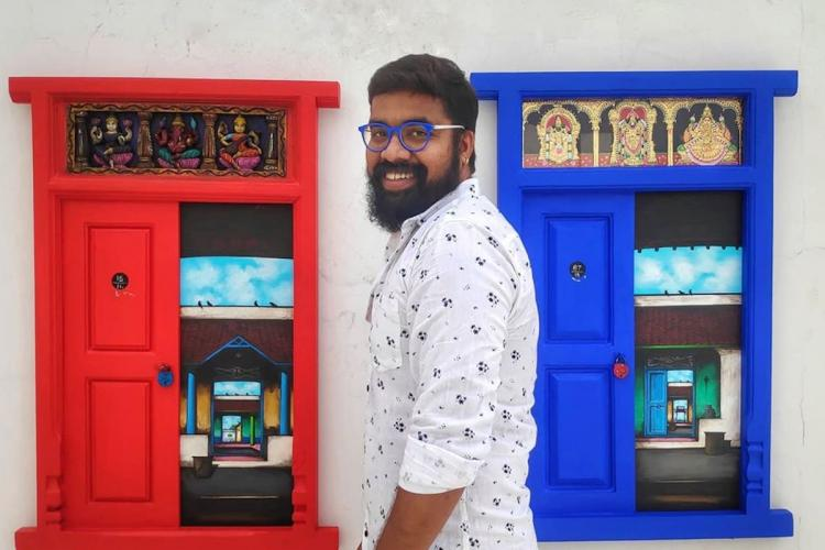 Artist Santhanam poses in front of his doors