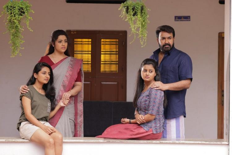 Mohanlal Meena Esther Anil and Ansiba in the poster of Drishyam 2