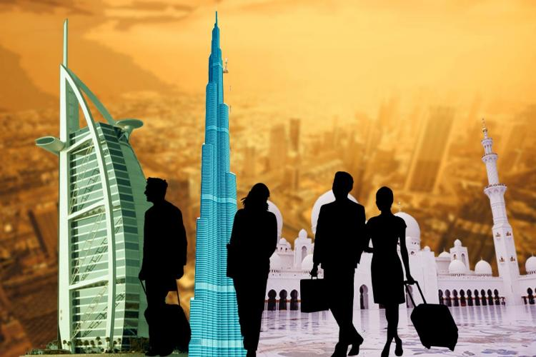 Silhouettes of travellers with background of Gulf buildings