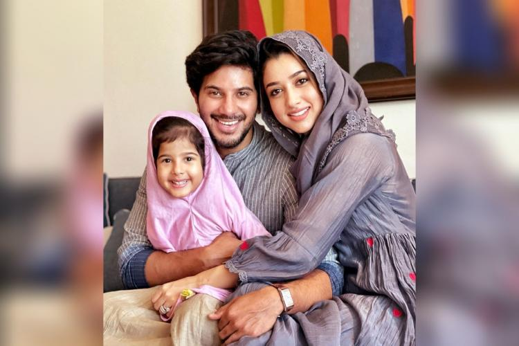 Dulquer Salmaan is seen along with his wife and daughter