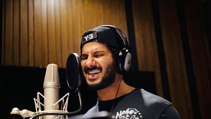 Dulquer Salmaan is seen recording a song in a studio