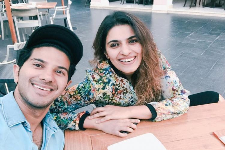 Dulquer is seen alongside his sister in the image