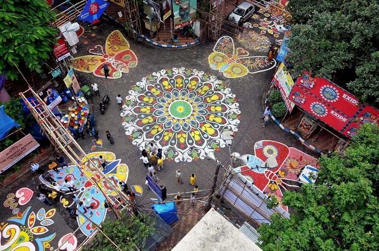 In pictures Kolkata celebrates Durga Puja create one-kilometer long floor art