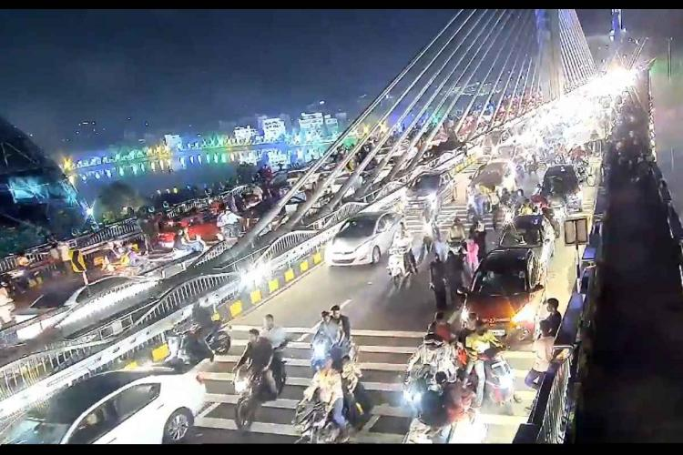 A screenshot from a viral video shows large crowds gathering at the bridge