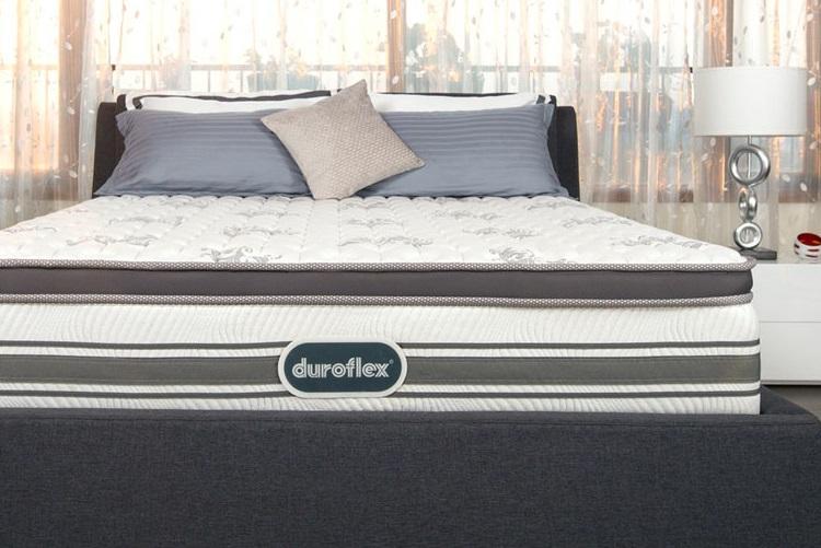 An image of a Duroflex mattress on a bedframe