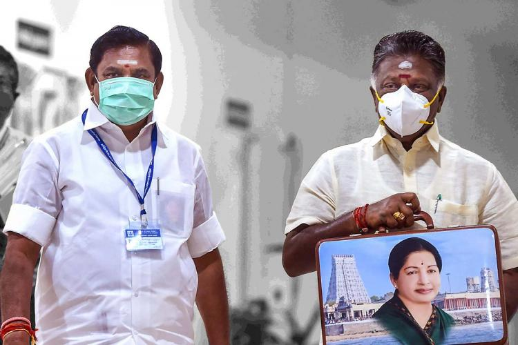 Tamil Nadu CM EPS on the left and Dy CM OPS on the right with a briefcase with Jayalalithaa's photo on it