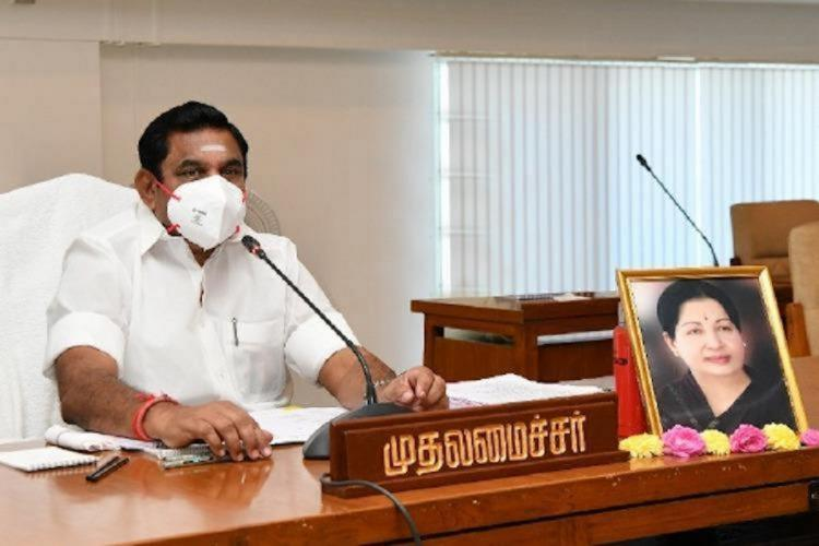 Tamil Nadu Chief Minister Edappadi Palaniswami sitting with a picture of Jayalalithaa in front of him