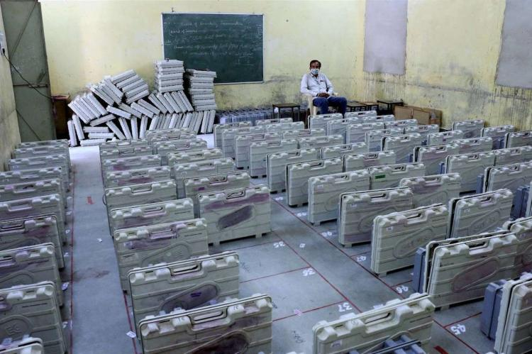 EVM machines being guarded at a centre