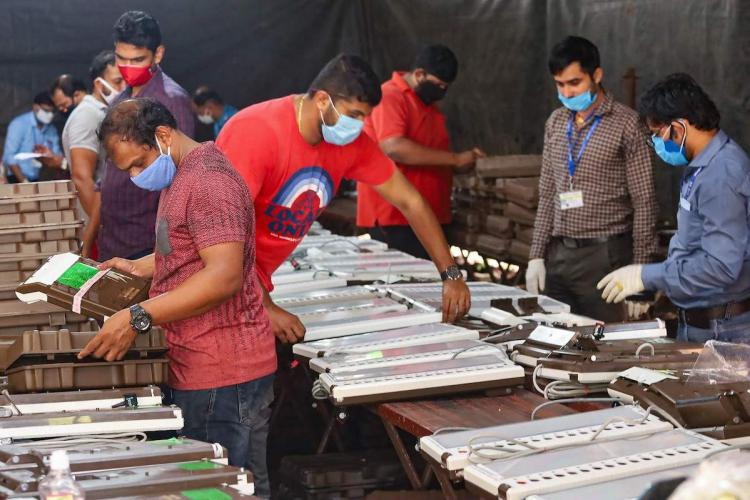 ECI workers preparing EVMs before polls