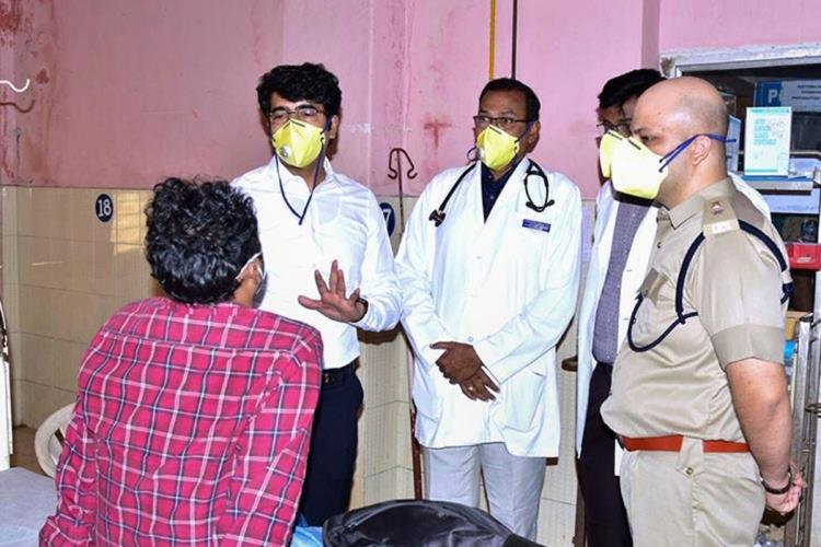Andhra doctors and officials interact with a patient in an isolation ward