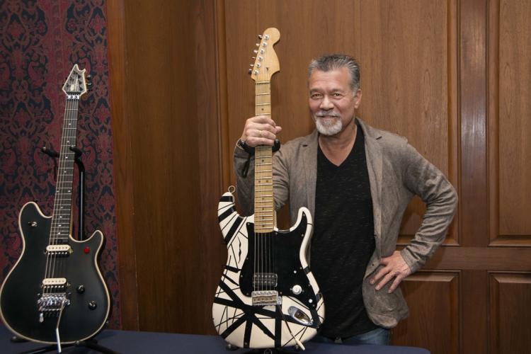 Eddie Van Halen holding a guitar at the Smithsonian Museum
