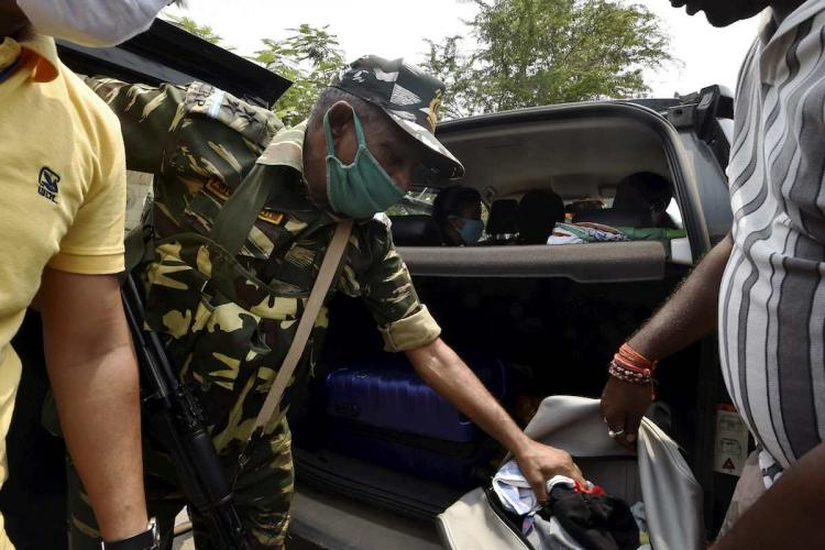 Nandigram CRPF jawans check a car at the entry point during West Bengal CM Mamata Banerjees public meeting ahead of West Bengal Assembly poll in Nandigram Sunday March 28 2021