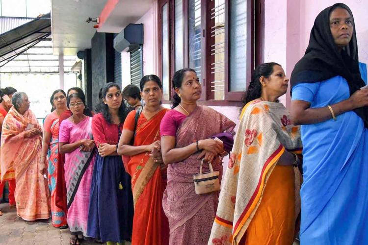 Women standing in a queue to enter voting station