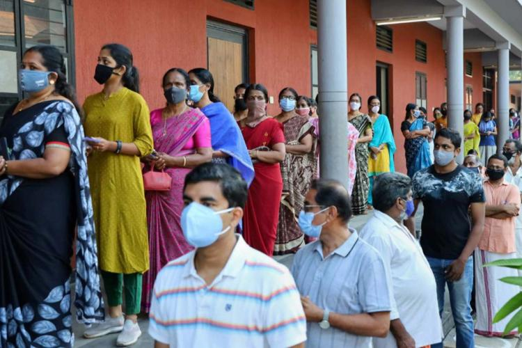 voters in booth wearing mask