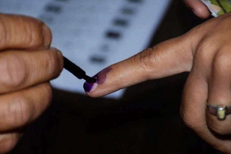 A voter being inked following the voting