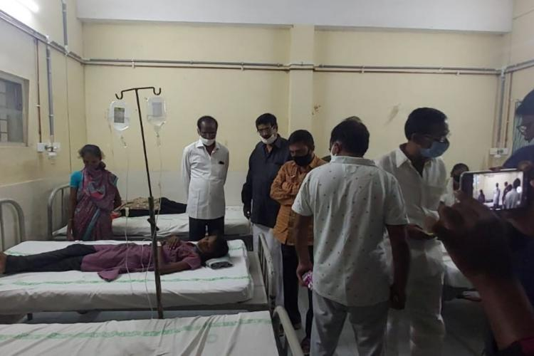 People being treated on hospital beds as West Godavari officials inspect them