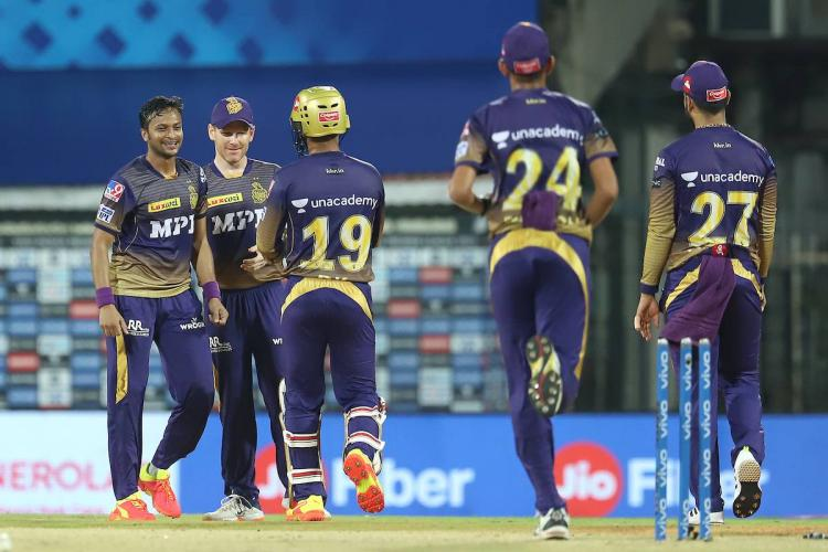 KKR teammates celebrate the fall of a wicket in the match against SRH.
