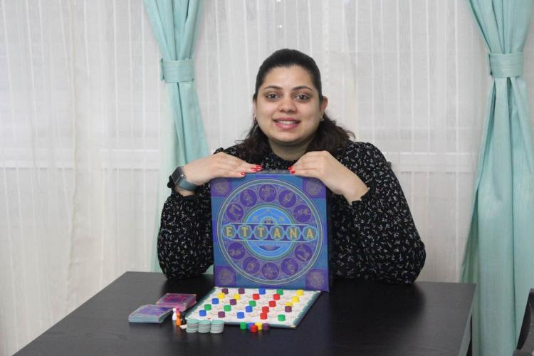Madhu sundar holding ettana boardgame
