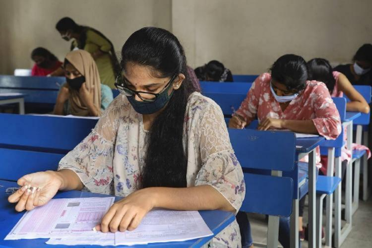 K-CET 2020 57 students infected with coronavirus write exam in separate rooms