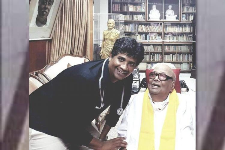 Dr Ezhilan with M Karunanidhi smiling for a photo at the latters Gopalapuram residence