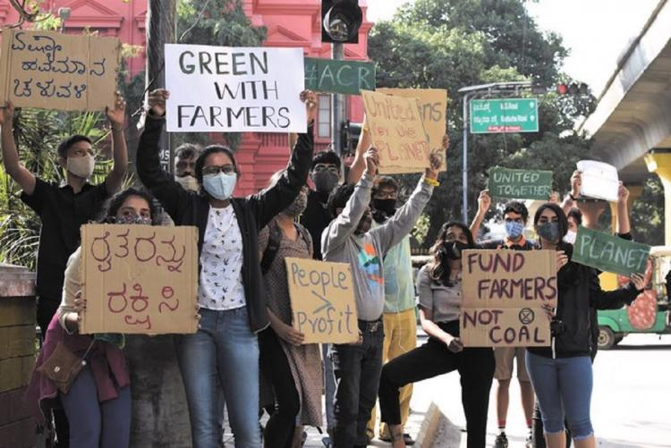 Fridays For Future or FFF members in Bengaluru holding placards for a pro farmer protests