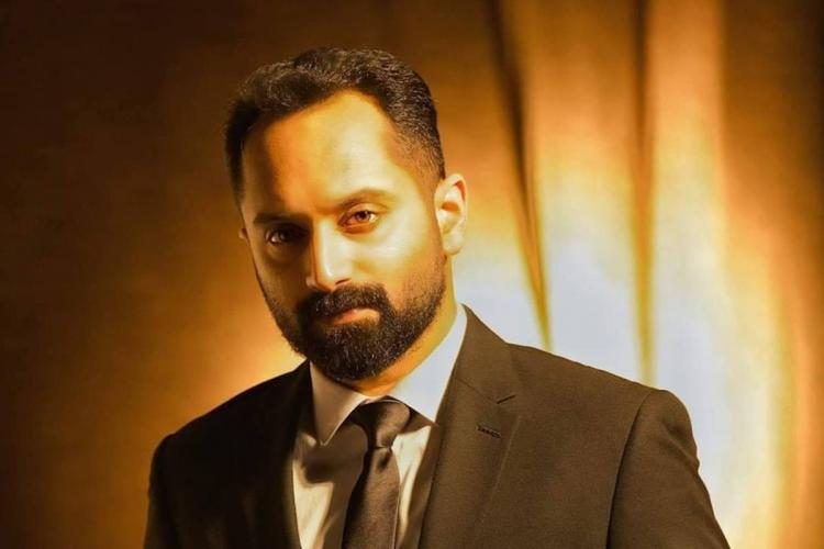 Fahad Faasil in a black suit