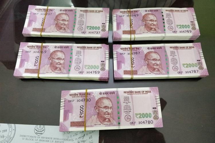 Fake Rs 2000 notes from Bangladesh seized near Vizag DRI arrests two