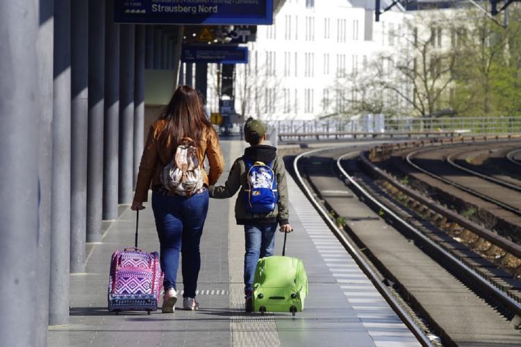 A family walks next to a railway line