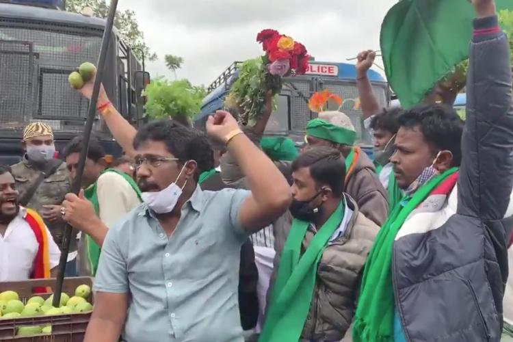 Farmer Dalit and labour organisations gathered outside Town Hall in Bengaluru to support the nationwide shutdown called on Tuesday against the Centres new farm laws