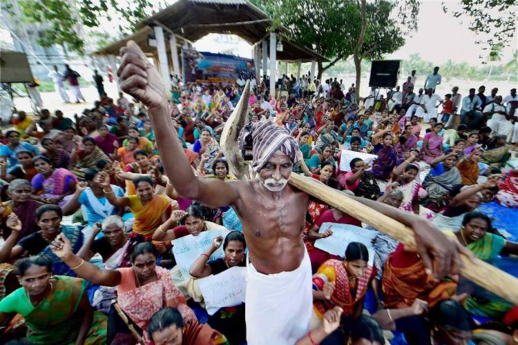 TN farmer holds up an equipment amid anti-hydrocarbon protests in Neduvasal
