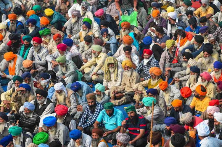 A big group of protesting farmers seen sitting during their Delhi Chalo march against the Centres new farm laws