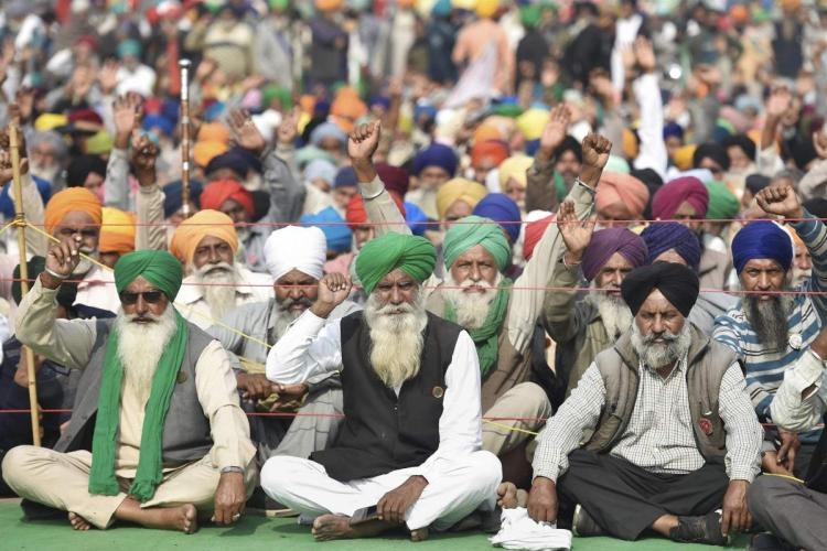 Farmers sitting on a road at Singhu border in protest against the controversial farm laws