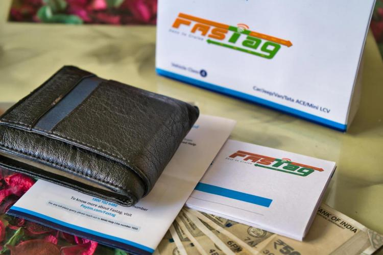 FASTag for vehicles wallet and currency notes placed on a table