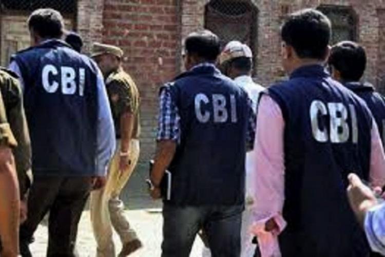 Officials of CBI during raids