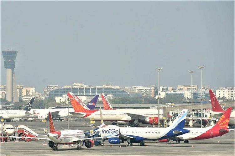 Flights of various carriers such as Air India and IndiGo parked on an airport tarmac