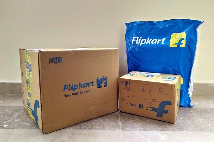 Two Flipkart boxes and one package with the logo on the packages
