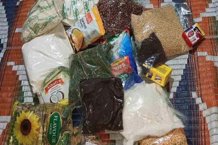 Free food kits distributed by Kerala government The picture shows items like pulses sugar salt rice soaps oil