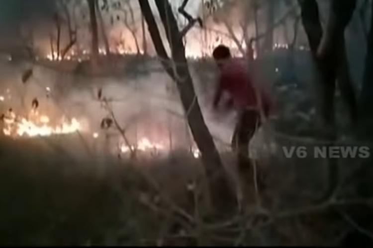 A man trying to douse the fire