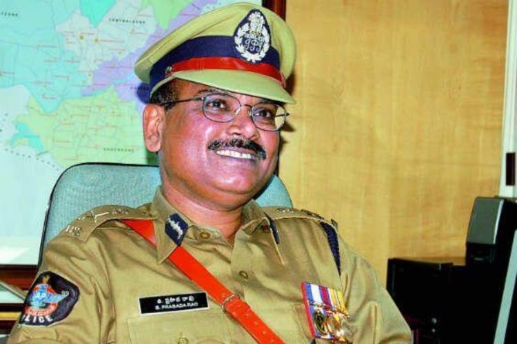 File photo of DGP Prasada Rao sitting on his desk