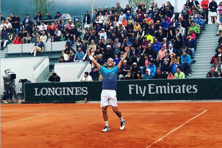 Cecchinato shocks Djokovic faces Thiem in French Open semis