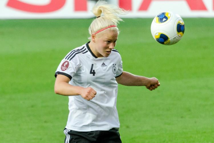 Women football players more vulnerable to injury from heading says new study