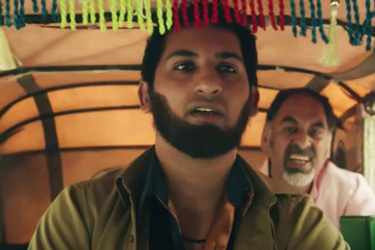 in this screengrab from the video Danish sait rides an auto in the film french biriyani behind him is a man looking agitated but danish looks very calm