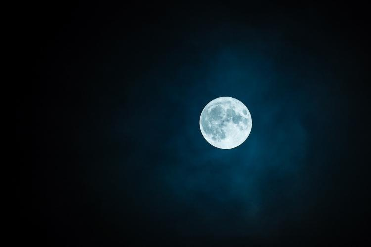 A view of the full moon in the sky