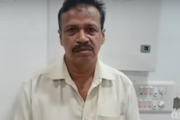 Screenshot of man in white shirt