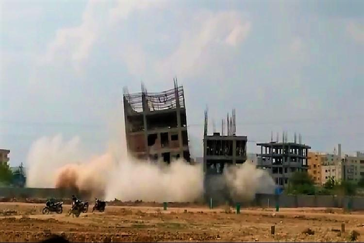Video Hyderabad municipal corporation tries to implode illegal building fails