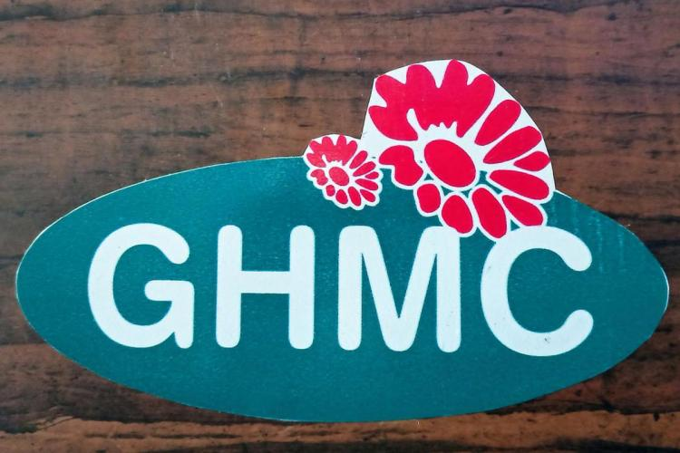 A board with GHMC written with pink flowers on it