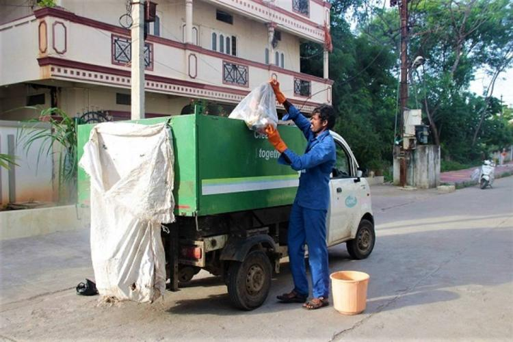 A file photo of a GHMC worker collecting garbage from households