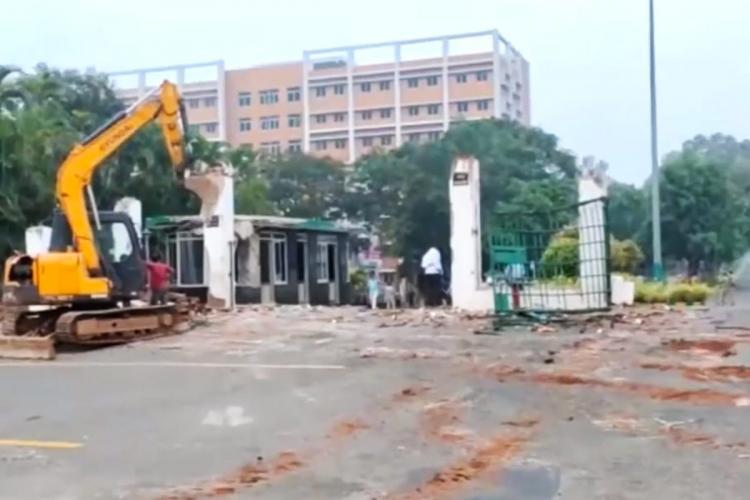 A JCB standing outside the entrance of GITAM University