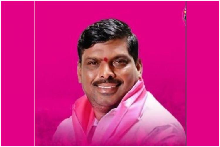 G Mahipal reddy wearing a white shirt in a pink background posing for a picture