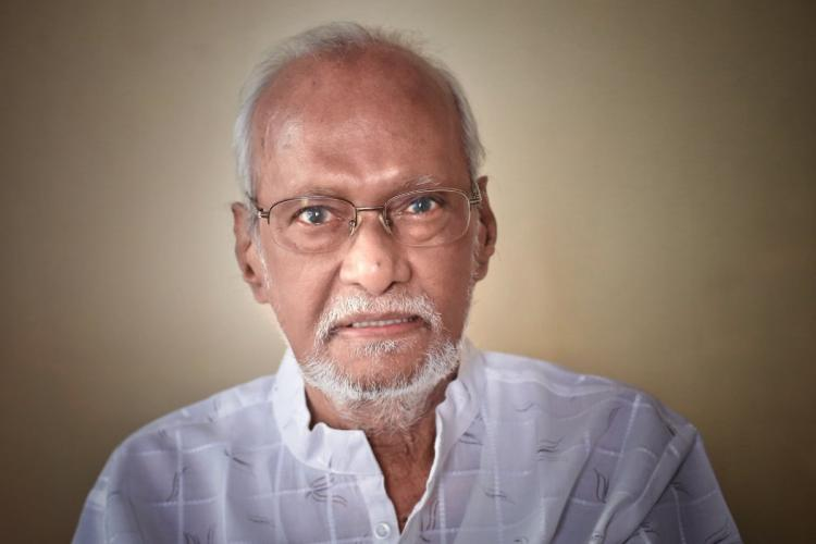 Director GN Rangarajan in a white shirt and specs